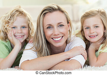 Mother with her children on the floor