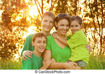 Mother with her children outdoors
