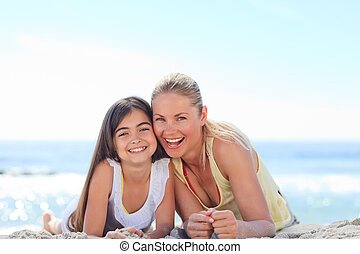 Mother with her daughter at the beach