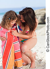 Mother with her daughter in a towel
