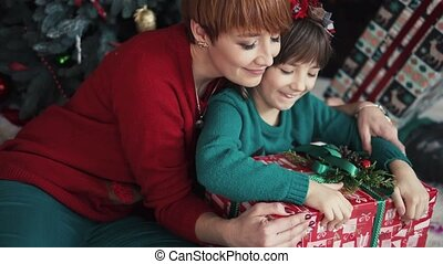 Mother with her Daughter in Christmas Time
