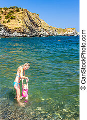 mother with her daughter in Mediterranean Sea, France