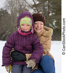 mother with her daughter in winter