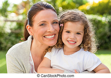 Mother with her daughter looking at