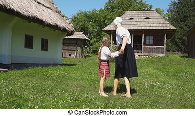 Mother with her daughter near the house