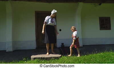 Mother with her daughter near the house - Mom and daughter...