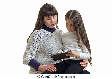 mother with her daughter using a mobile tablet