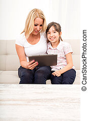 Mother with her Daughter using a Tablet PC