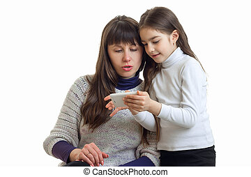 mother with her daughter using mobile tablet