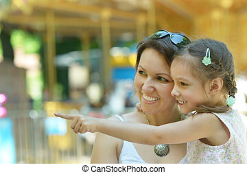 Mother with her daughter walk in summer