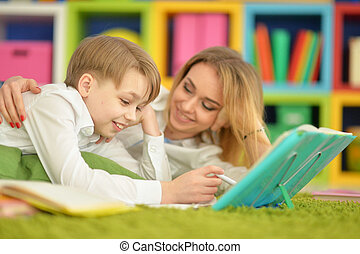 Mother with her son doing homework