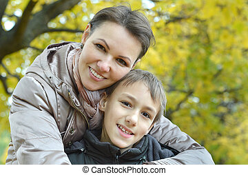 Mother with her son in the park