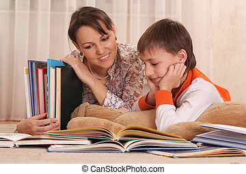 mother with her son reading a book