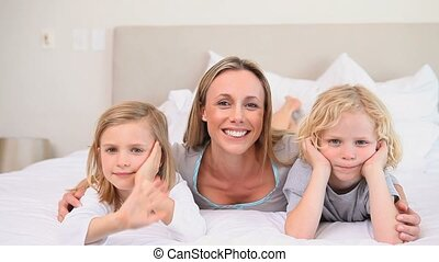 Mother with her two children waving at the camera