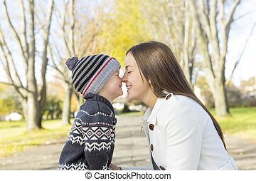 Mother with kid autumn park