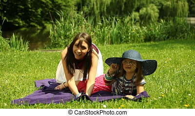 Mother with kid having fun outdoor