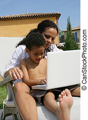 mother with kid using computer