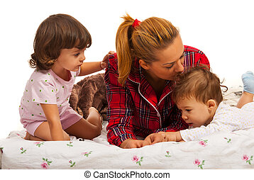 Mother with kids in bed