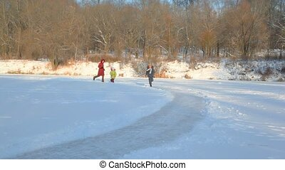 mother with kids runs to camera in snowfield