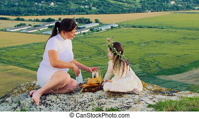 Mother With Little Daughter At Nature