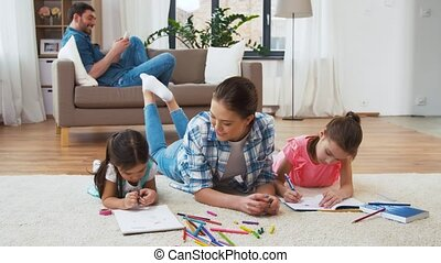 mother with little daughters drawing at home - family,...