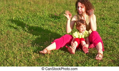 mother with little girl on grass 2