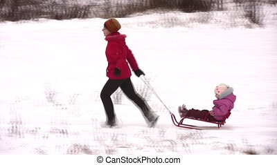 mother with little girl on sled - Mother with little girl on...