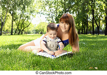 Mother with little son in the park