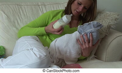Mother with new born Baby - Mother Feeding her new born baby