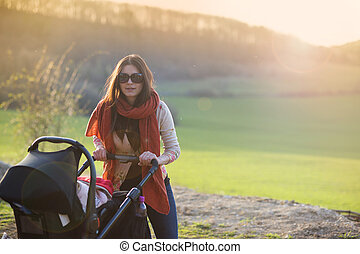 Mother with pram in nature