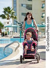 mother with  pram  walking  at resort