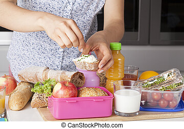 Mother with small sandwich