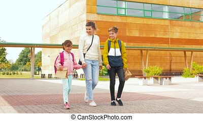 mother with son and daughter going to school - education and...
