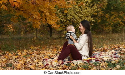 mother with son in autumn park