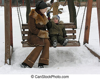 mother with son on bench.