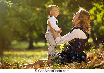 Mother with son playing in park