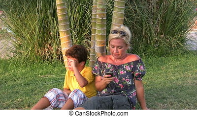 Mother with son talking on phone
