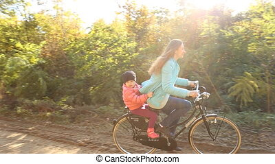 Mother with the child and bike