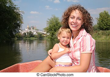 mother with the daughter in the boat
