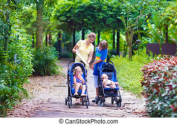 Mother with three children in a park