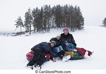 Mother with three children outdoors in winter