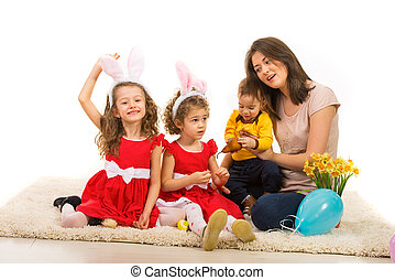 Mother with three kids celebrate Easter