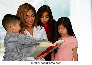 Mother with three kids reading