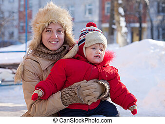 mother with toddler  in winter