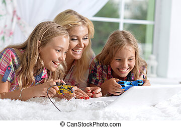 Mother with two adorable twins playing