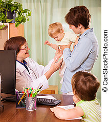 mother with two children and  pediatrician doctor