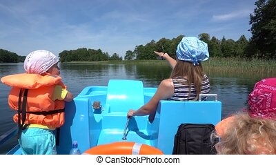 Mother with two children boy and girl have fun in catamaran. Gimbal motion back