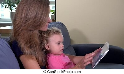 Mother woman teaching toddler girl using tablet computer. 4K