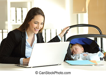 Mother working taking care of her baby at office
