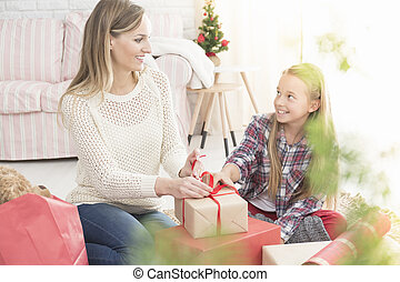 Mother wrapping gift box
